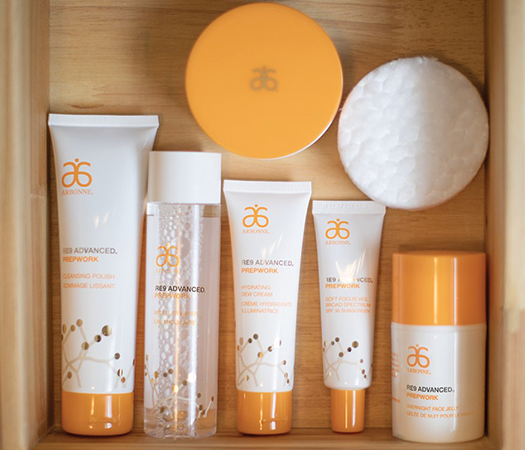 Display of beauty products by Arbonne